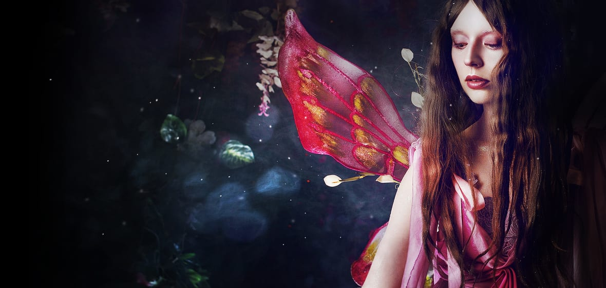 Young beautiful woman in the image of fairies, magic dark forest
